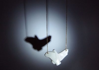 Shadow talks bird necklace